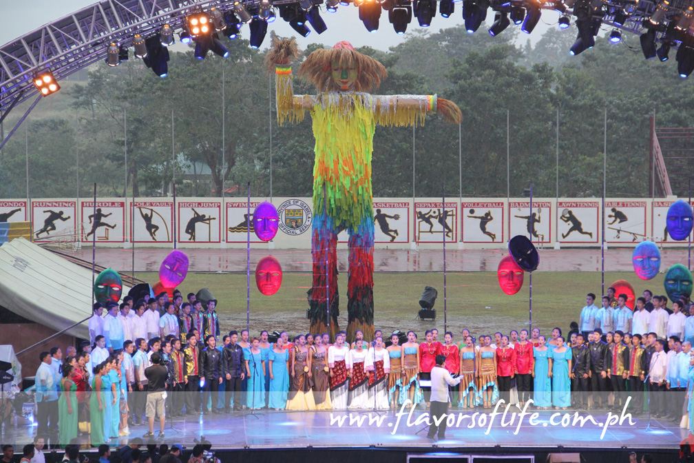 The choir singing on stage, against the backdrop of a giant bambanti, to mark the formal start of the Bambanti Festival festivities