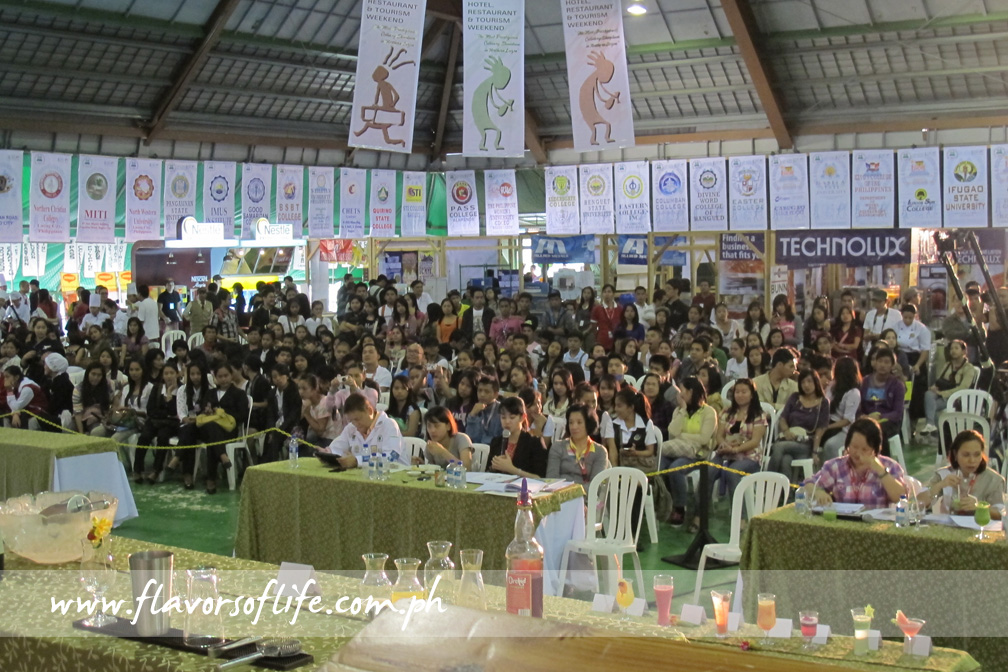 A crowd gathers at the Multi Purpose Hall for the mocktail mixing competitions