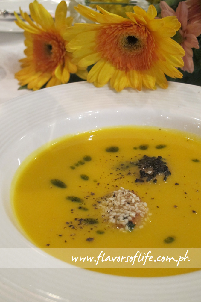 Pumpkin and Ginger Soup with Seared Scallops and Sesame, a signature dish of InterContinental Berlin, Germany