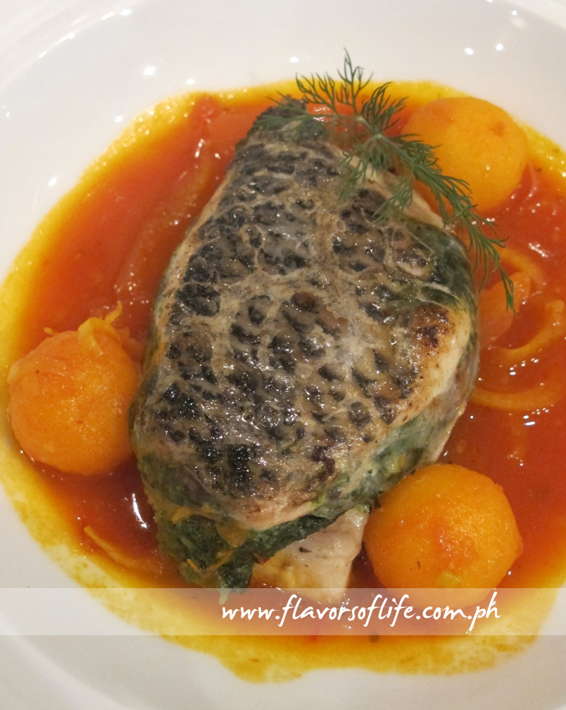 Mediterranean Style Tilapia Fillet with Pig's Caul, Kalamata Olive Tapenade, Spinach, Tomatoes and Saffron Potatoes, a culinary masterpiece of InterContinental Paphos, Cyprus