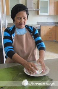 Natividad Ricafrente of Ilagan, Isabela, shows how to make binallay