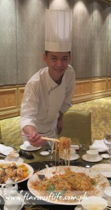 Chef Richard Thong of Makati Shangri-La Hotel's The Shang Palace demonstrates how to do the prosperity toss with the Yee Sang Salad on Chinese New Year