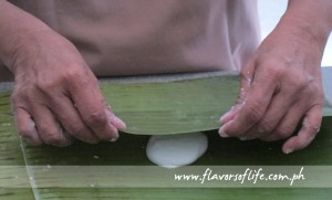 Step 3: Place flattened dough in the center of a small sheet of banana leaf.