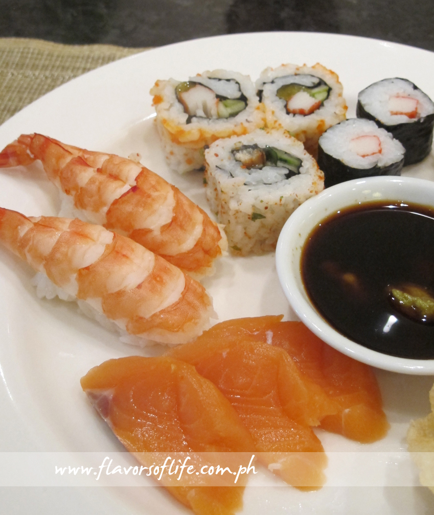 Platter of Salmon Sashimi, Ebi Sushi, California Maki and Kani Sushi
