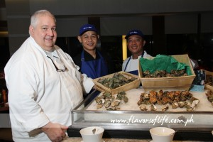 Area executive chef Paul Lenz and his Makati Shangri-La chefs check on the freshness of the oysters at the oyster bar