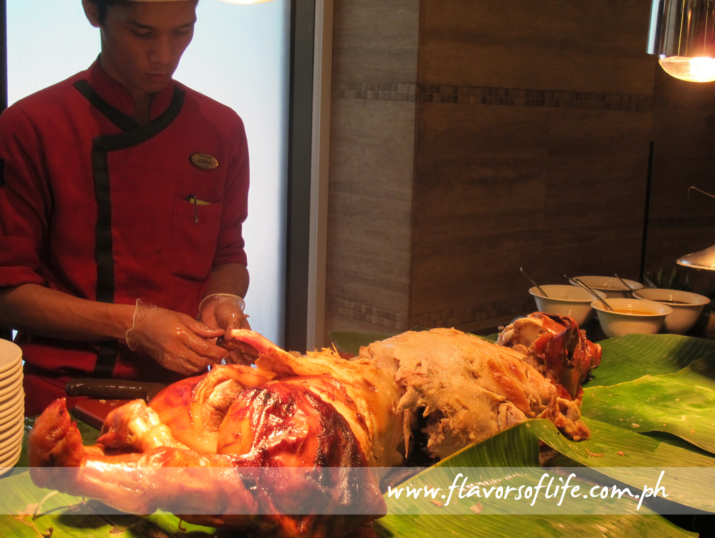 A whole lechon at the carving station of Basix All-Day Dining