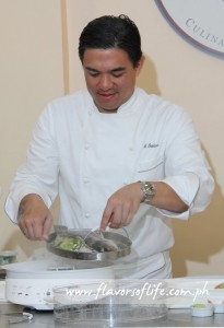 Chef J Gamboa at work on the steamed fish dish at The Maya Kitchen