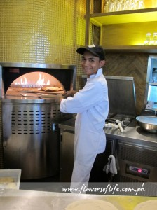 Making CPK's gourmet pizzas and serving them straight out of the oven