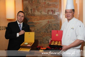 Mandarin Oriental Manila's director of food and beverage Peter Pysk and Executive Chinese Chef Hann Furn Ch showing the mooncake boxes available this year