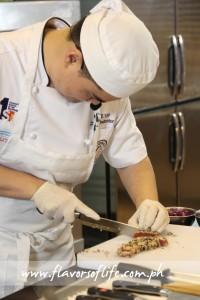 Global Academy's culinary program director Chef Michael Yap cuting his Seared Tuna with the new Wusthof Yanagiba Knife