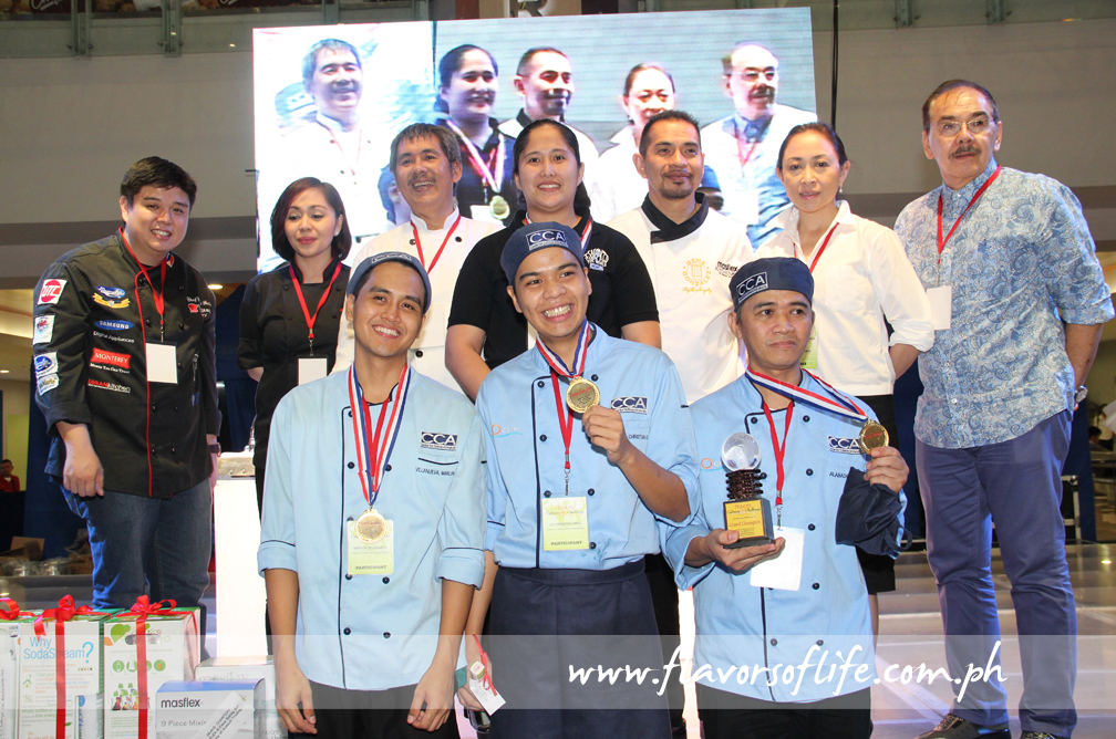 Grand prize winning team Center for Culinary Arts-Oceana Branch with members of the Board of Judges