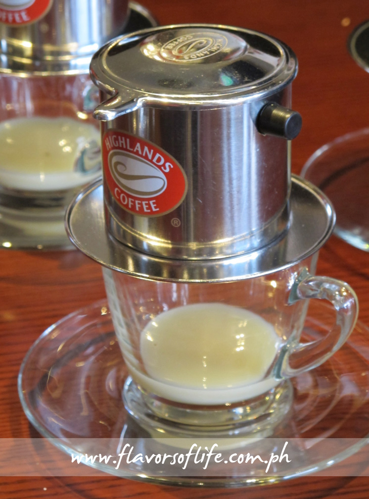 Vietnamese Coffee drips into the cup with evaporated milk (Highland Coffee)