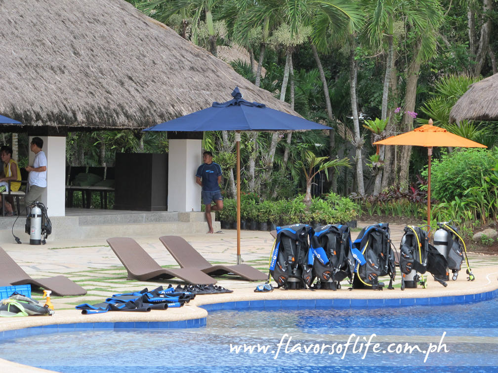 Scuba diving equipment and gear by the infinity pool