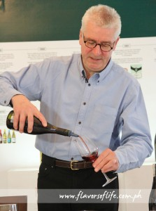 Marks & Spencer wine expert Chris Murphy pouring red wine for tasting