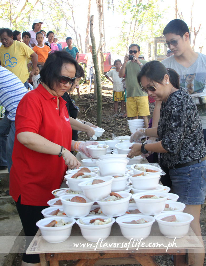 Vangie, Angelo and me portioning the food