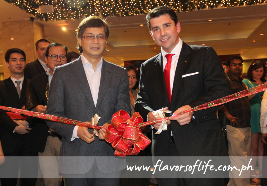 Cutting the ceremonial ribbon to signify the soft opening of the hotel's newly refurbished Lobby Lounge this time...