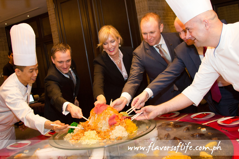 Sofitel's officials leading the Yee Sang Salad prosperity toss