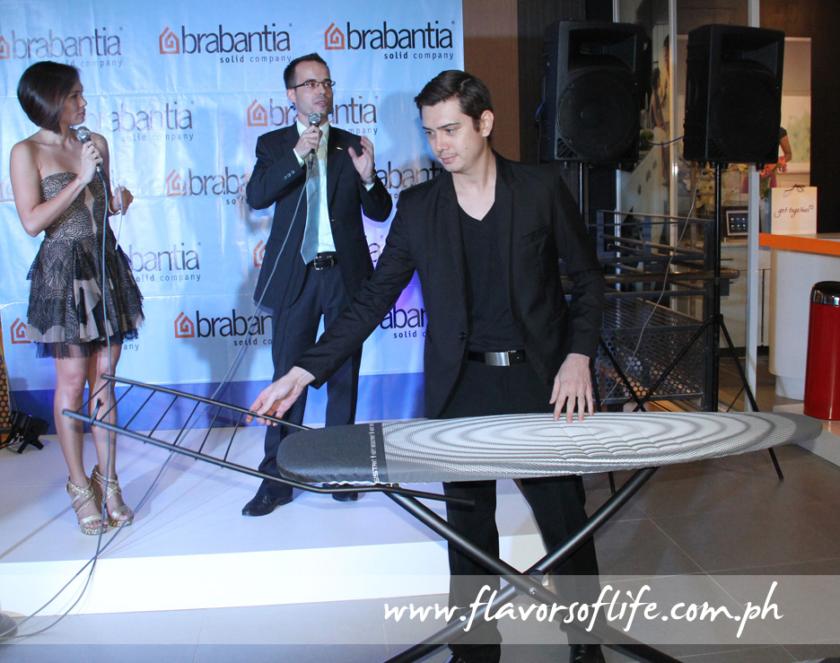 Brabantia's iconic ironing board is presented by a model during the formal store opening hosted by Issa Litton with guest of honor Danny den Hartog, Brabantia's sales manager for Asia Pacific