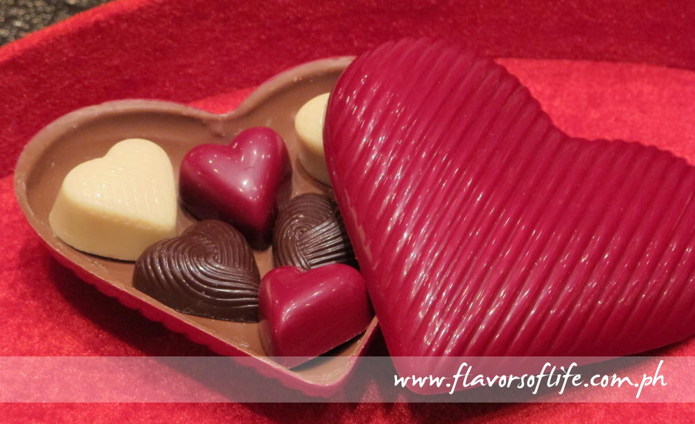 Heart-shaped pralines in a chocolate heart box