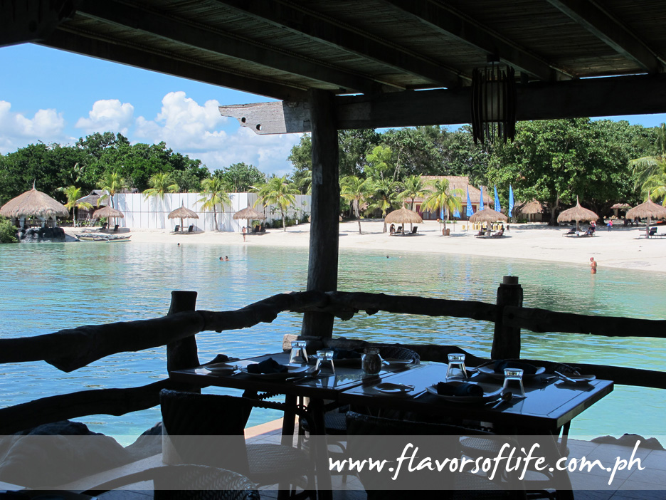 The Cove Live Seafood Restaurant at Bluewater Maribago Resort extends out to sea from the beach area of the resort