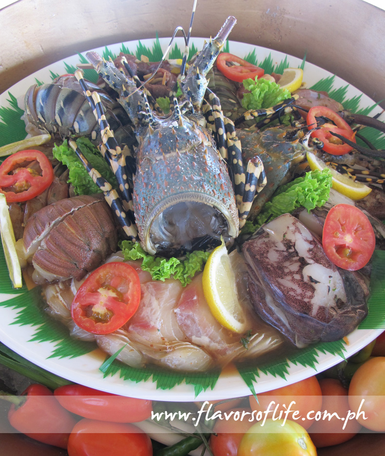 Platter of fresh seafood ready to be grilled