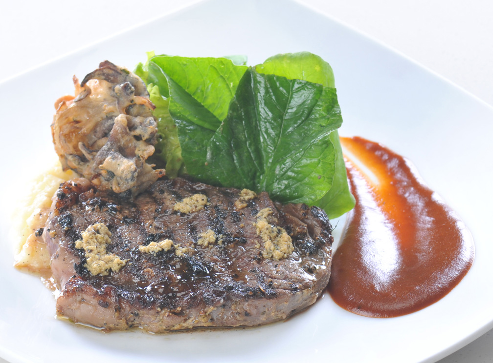 Roasted Rib-eye STeak with Onions and Portabello Confit served with Potato Puree & Classic Brown Sauce