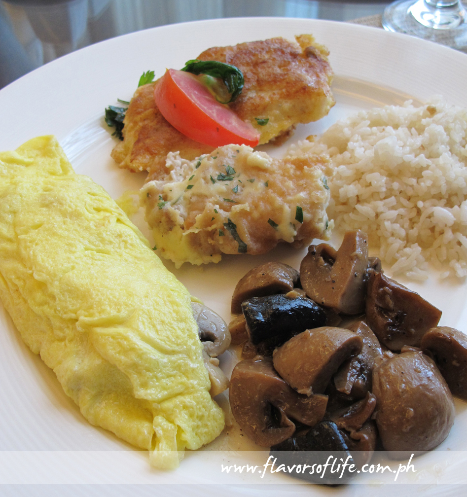 My breakfast platter of Button Mushrooms al Ajillo, Mushroom, Tomato and Cheese Omelette, Fish Fillet and Country Fried Chicken with Béchamel Sauce, with Garlic Rice