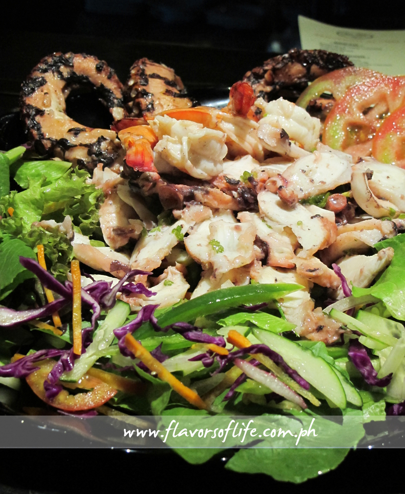 Insalata de Mare teeming with slices of grilled octopus from Balayan Bay