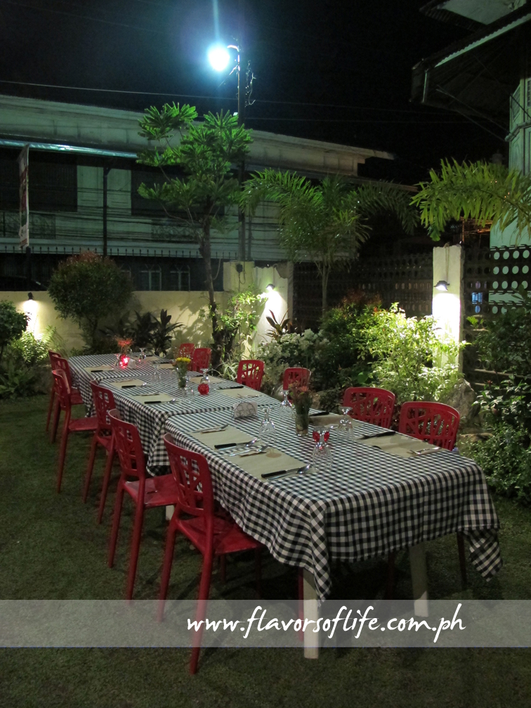 Romantic dining setup in the garden of Chez Deo in the evening