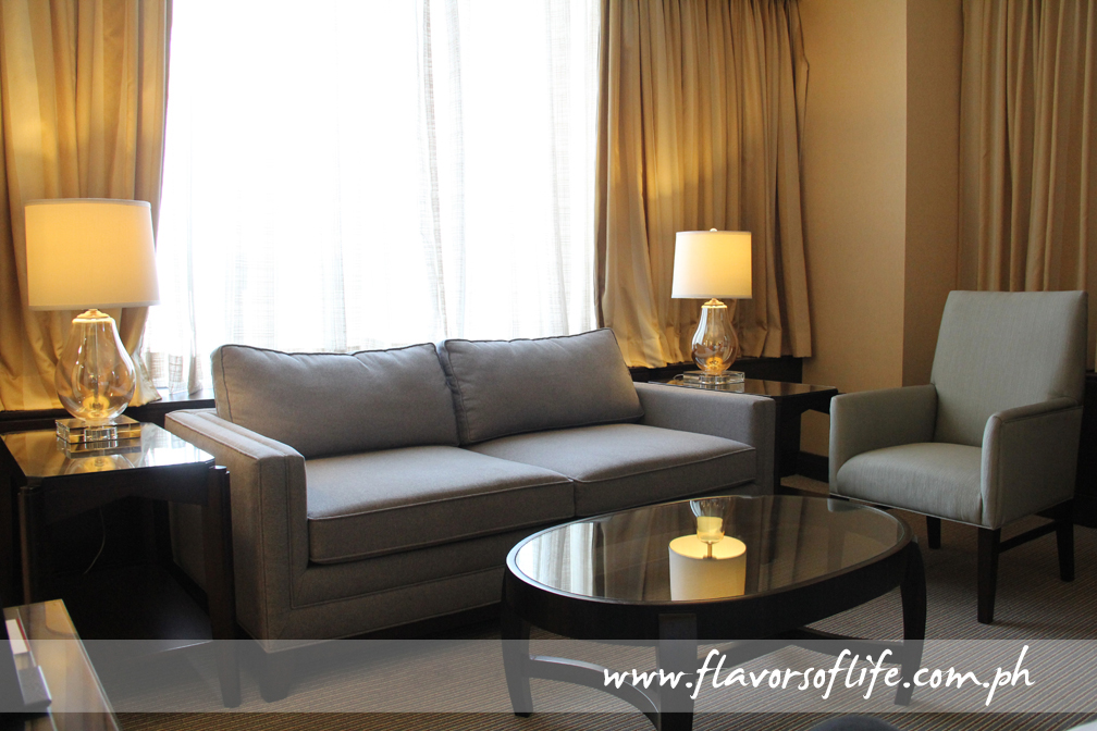 The receiving area of the Executive Room with a picturesque view of the Alabang cityscape at the back