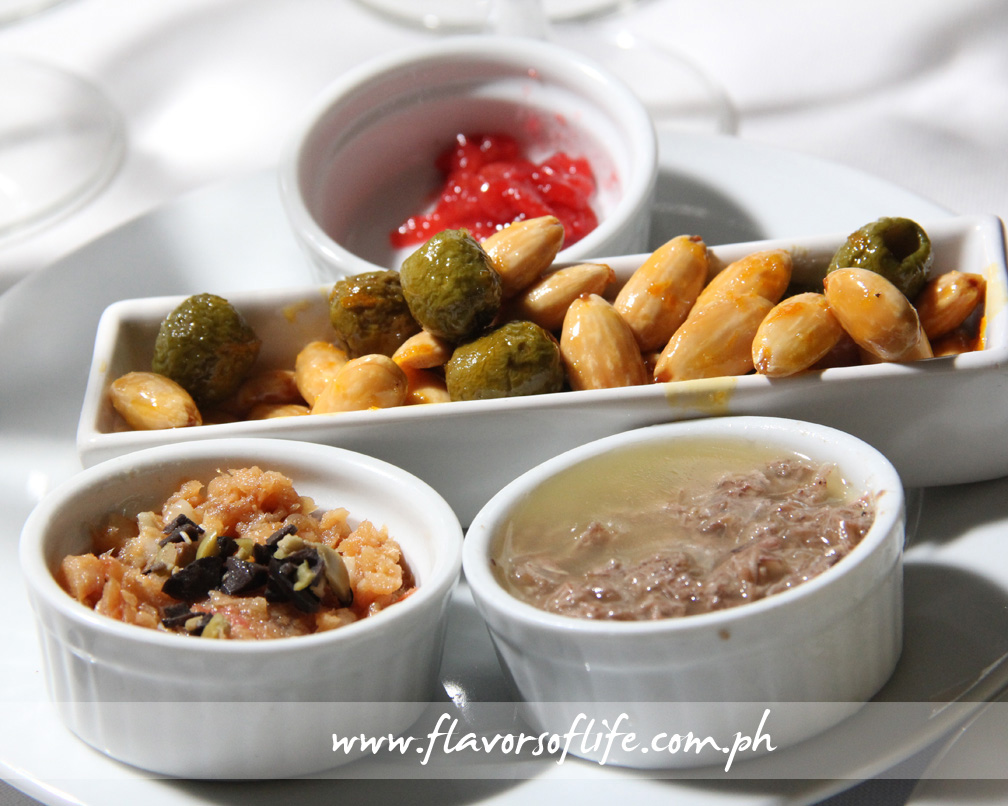 Fried Olives and Almonds, with chips of Bacalao, Rillettes of Pork, and Confit of Guava
