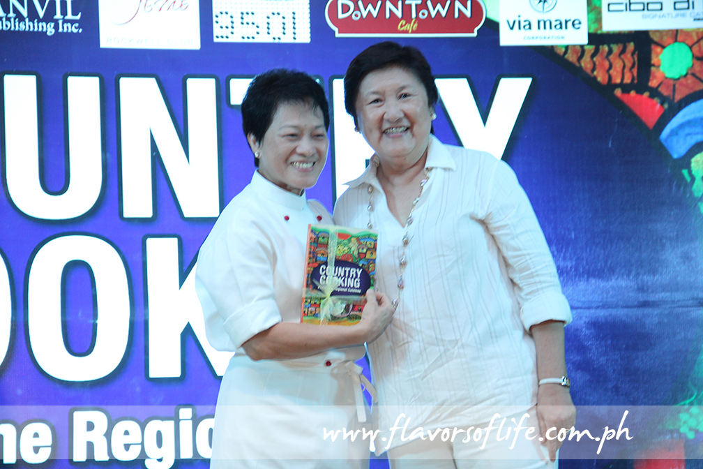 Chef Jessie Sincioco receiving a copy of the book from author Michaela 'Micky' Fenix