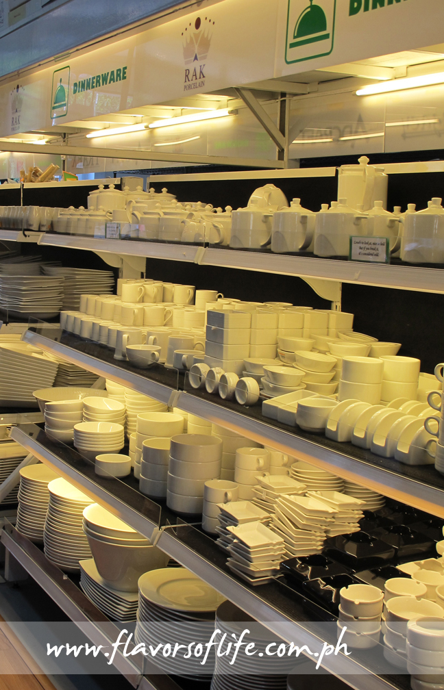 Plates and bowls of all sizes and shapes on the shelves of MOK