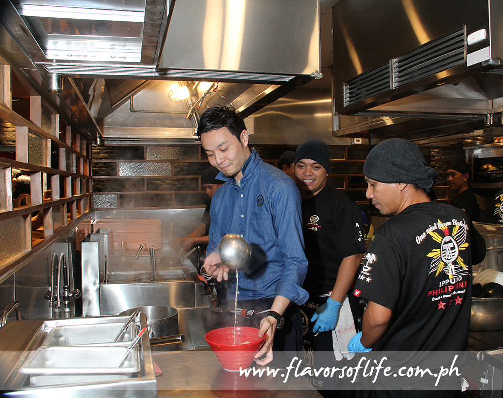 Ippudo Philippines operations manager Yota Shiiba in the kitchen with the staff