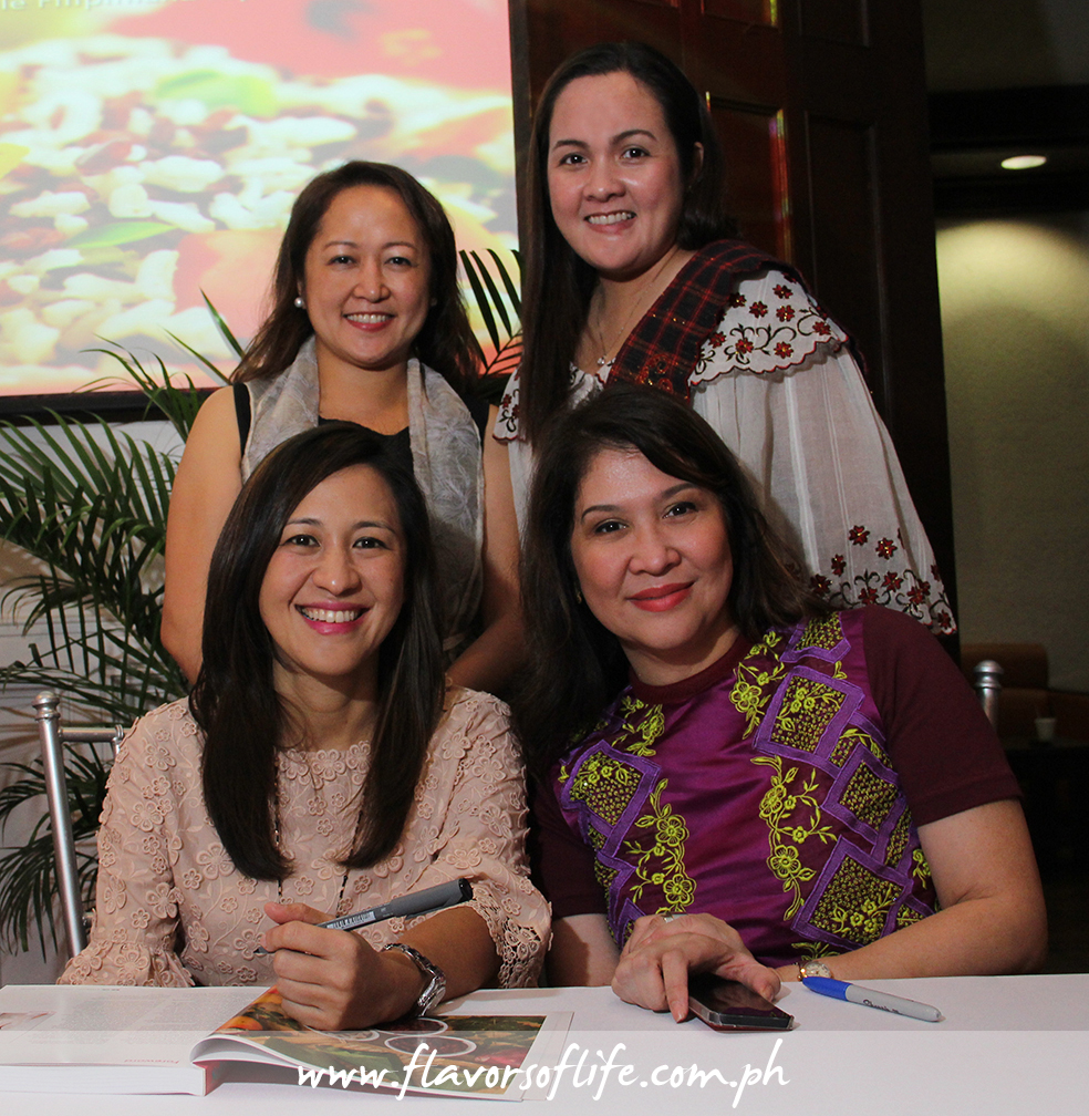 CSFI board treasurer Kristine Meehan and executive director Paula Camille Bondoc join CSFI chairperson Joy Belmonte and Salu-Salo editor-in-chief Mons Romulo during the book signing...