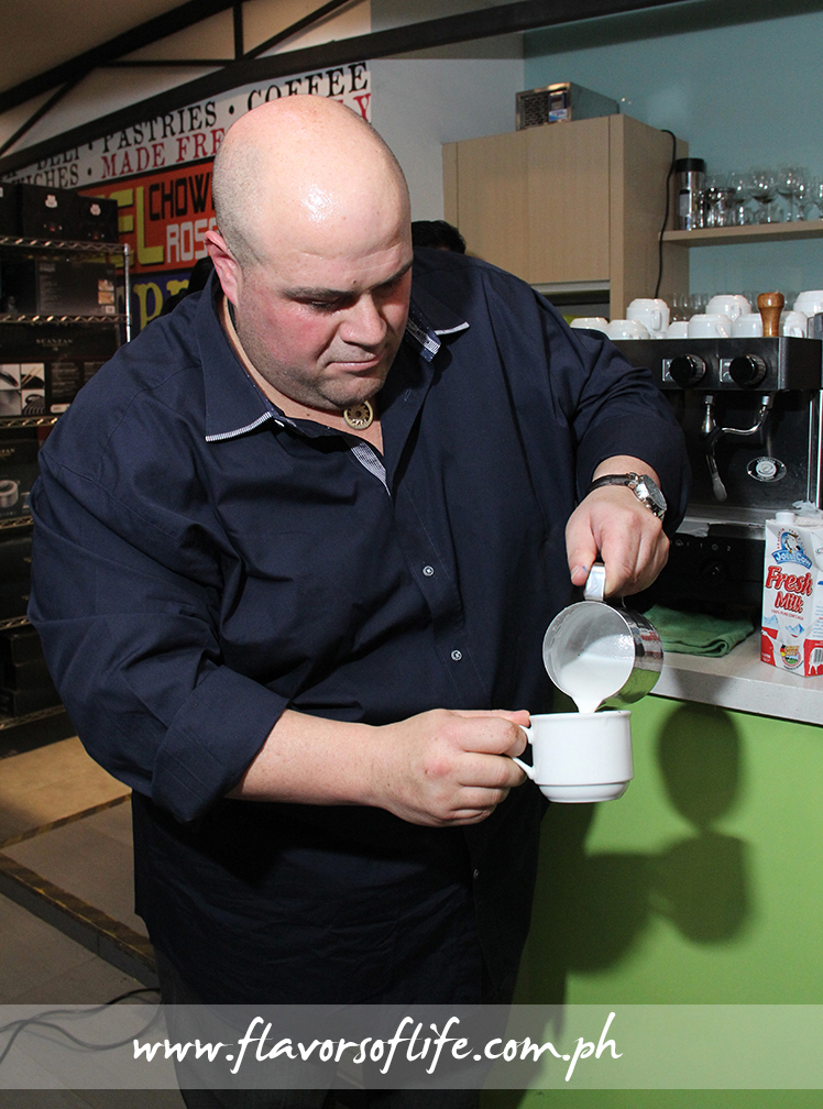 Phillip Di Bella doing latte art on his cup of coffee now...