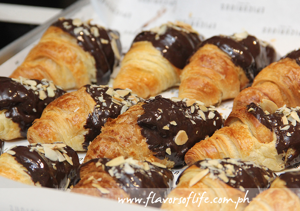 Crisp and flaky croissants dipped in chocolate