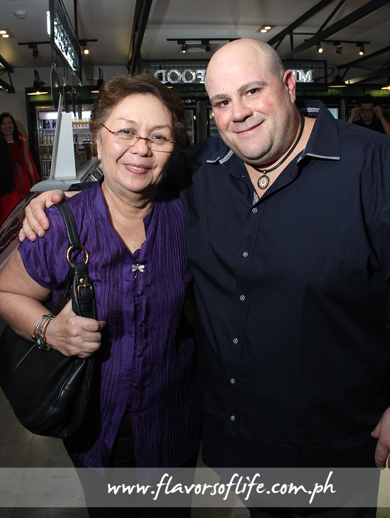 The Cravings Group founder Susana 'Annie' Guerrero and Di Bella Coffee owner Phillip Di Bella seal the partnership that aims to bring the premium Aussie coffee experience to the Philippines