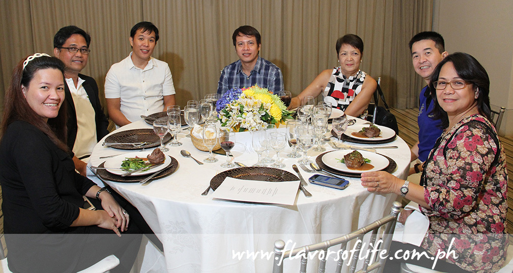 USPB Philippines' Evelyn Mercurio (extreme right) having a good Thanksgiving Dinner and chat with guests
