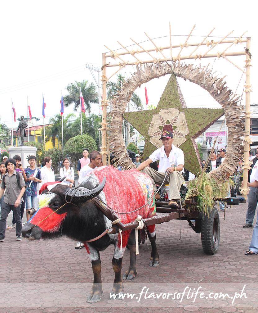 Barangay Sumapang Matanda had its parol pulled by a carabao painted with the Philippine flag
