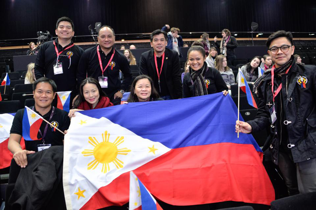 Team Philippines waving the Philippine flag in the 205 Coupe du Monde de la Patisserie in Lyon, France