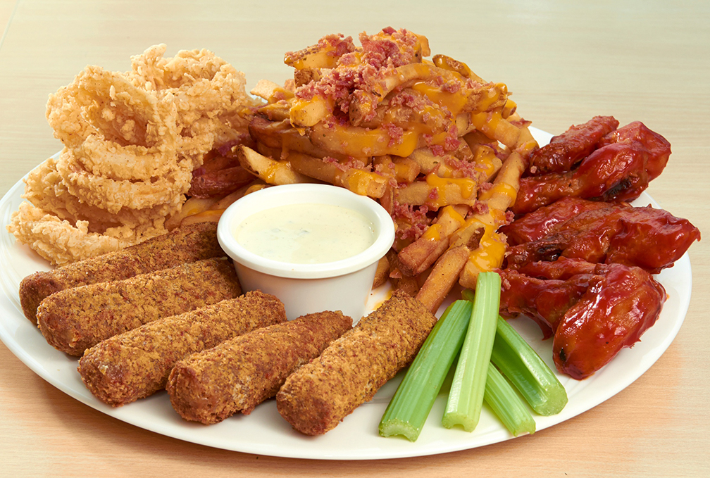 Burgoo's Supreme Sampler appetizer platter which combines, clockwise from top left: Onion Rings, __, Buffalo Wings, and Mozzarella Sticks