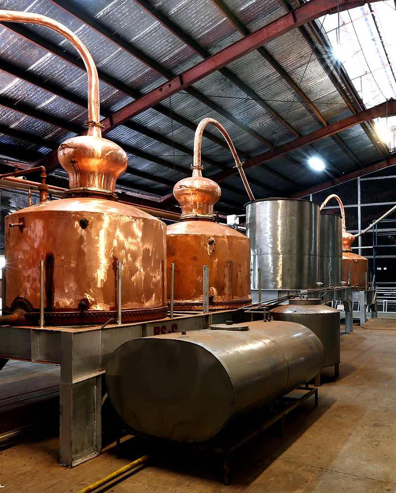 Making rum via batch distillation in a copper pot still...