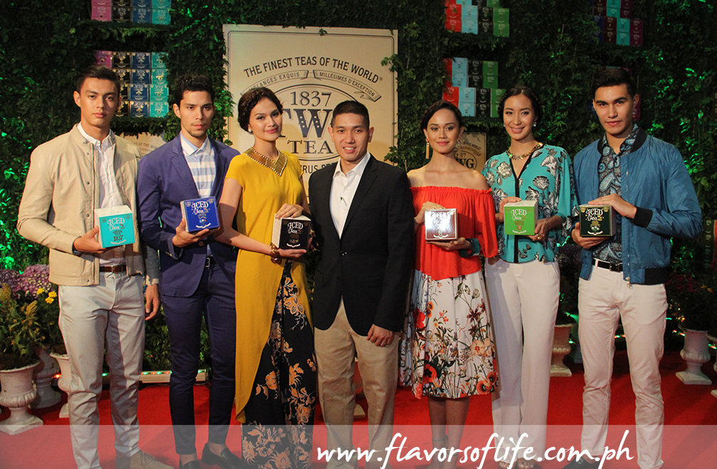 Stores Specialists Inc.'s Mike Hwang and the models carrying variants from the TWG Tea Iced Teabag Collection during the formal launch