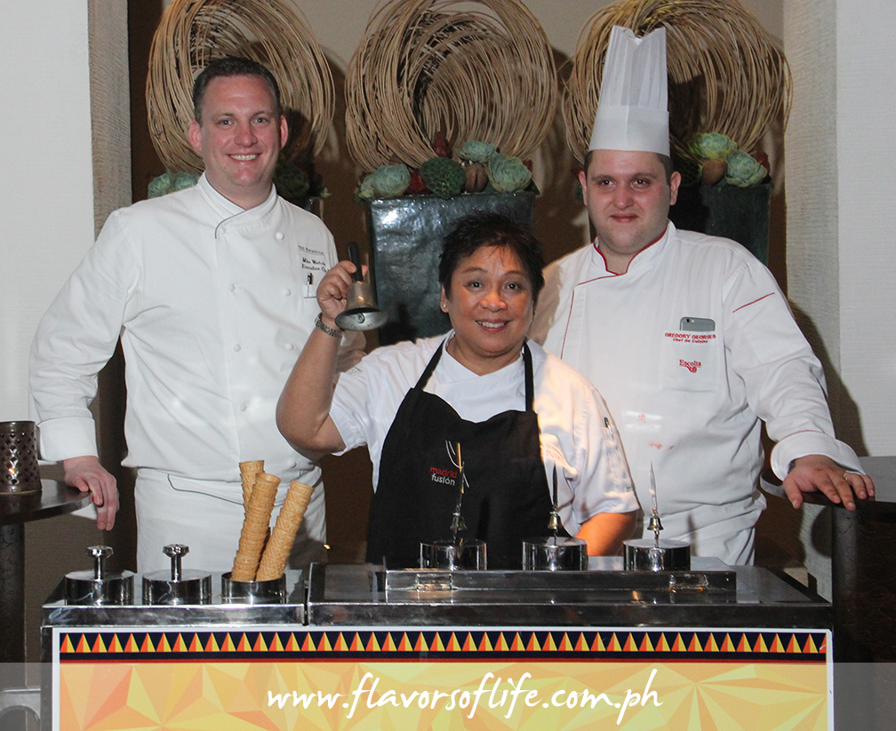 Fiesta Filipina guest chef Myrna Segismundo, flanked by The Peninsula Manila's executive chef Mike Wehrle and chef de cuisine Gregory George, ringing the bell of the sorbetes cart