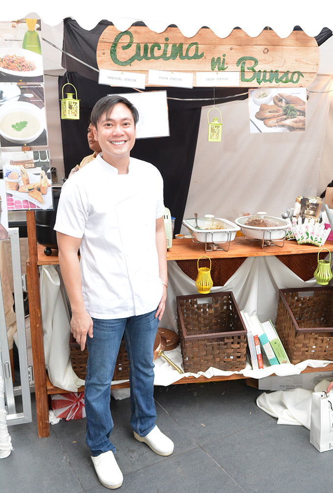 Mel Martinez in front of his Cucina ni Bunso booth