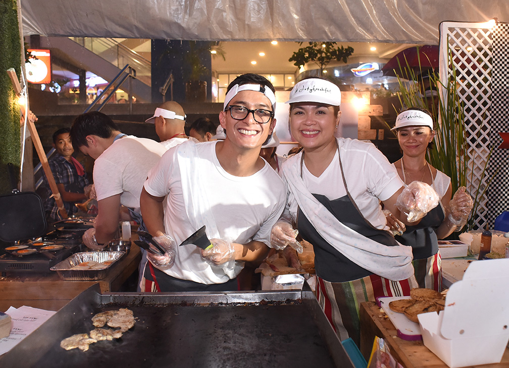 Celebrity couple Ryan Agoncillo and Judy Ann Santos cook up and serve Dirty Breakfast in their booth at U.P. Town Center's 'Open Kitchen' event