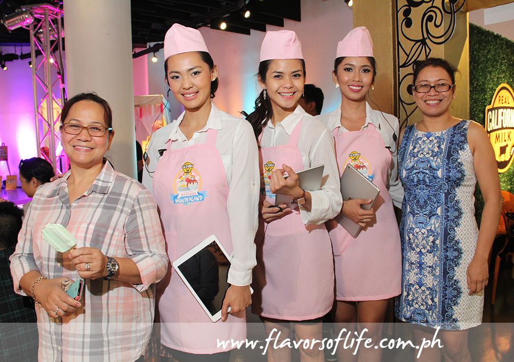 Synergy Asia's Evelyn Mercurio (extreme left) and Reji Retugal Onal (extreme right) with the ice cream ladies