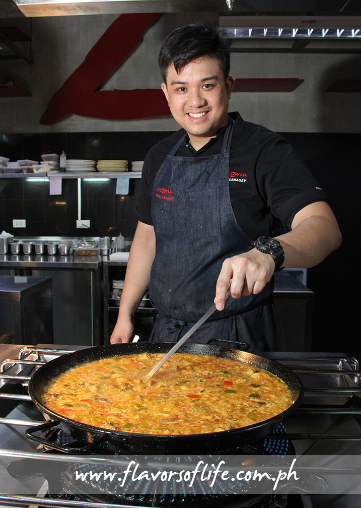 Cooking a huge serving of paella for guests who graced Arrozeria's formal opening
