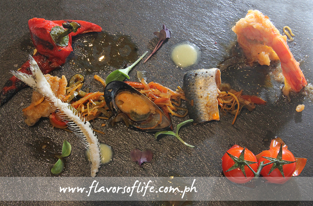 Seafood Escabeche, Manila Clams, Tiger Prawn, Mussels, Sardines, Olive Coulis, Chantarelles, with Deep-fried Sardine Bone Chips